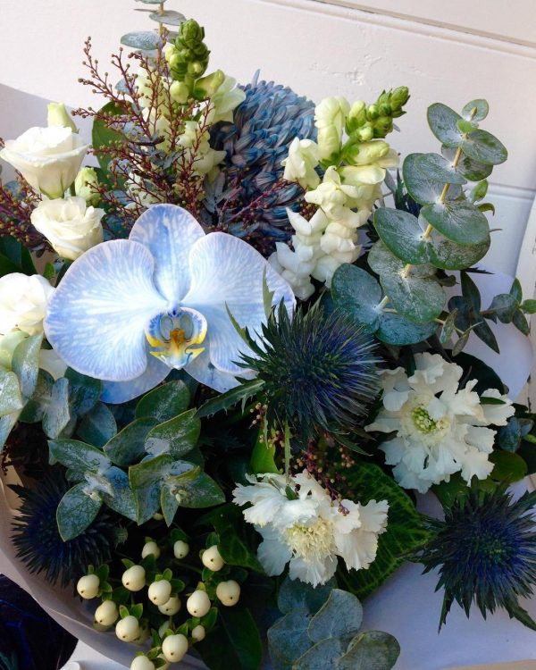 a bouquet of blue and white flowers