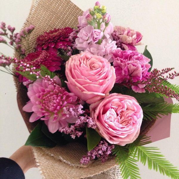 a bouquet of pink and purple flowers