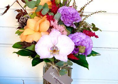 flower arrangement in a jar
