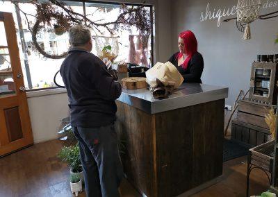 a man and a woman inside a shique floral design shop