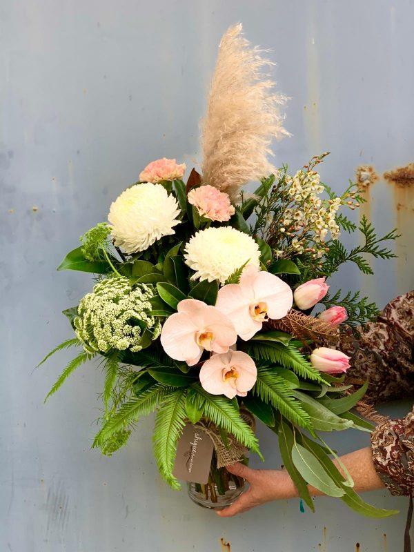 flower arrangement in a tall vase
