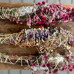 stems of beautiful flowers on wooden plank
